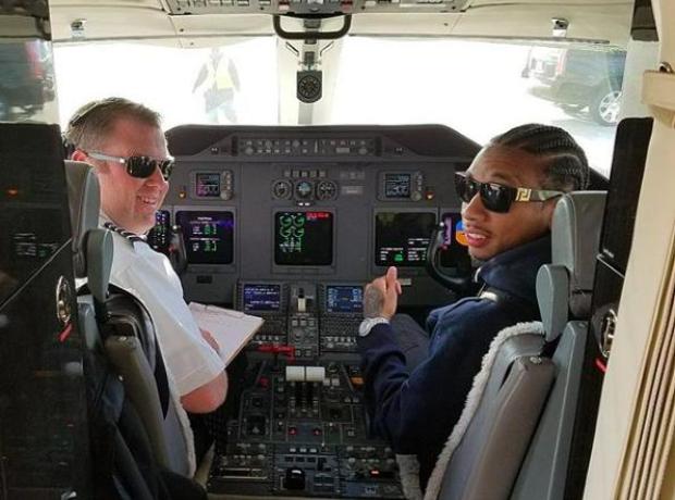 Tyga flying a plane