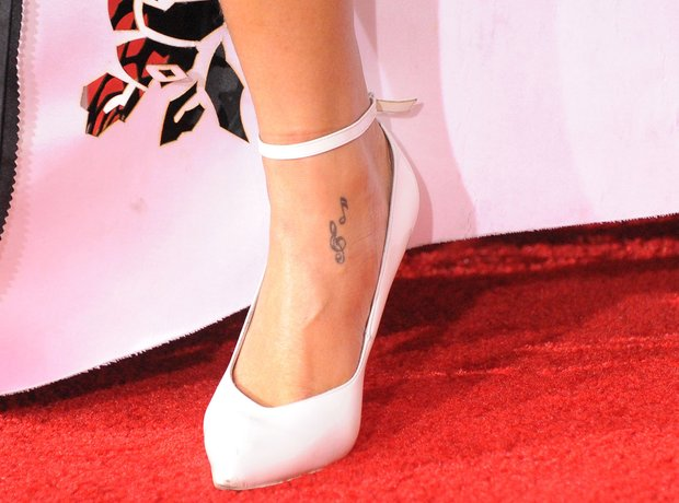 RIhanna musical note foot tattoo