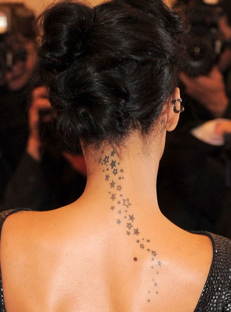 0907a0686cf66 A Guide To Rihanna's Tattoos: Her 25 Inkings And What They Mean ...
