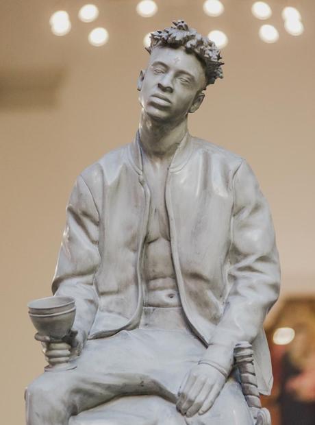Rap Caviar Statue