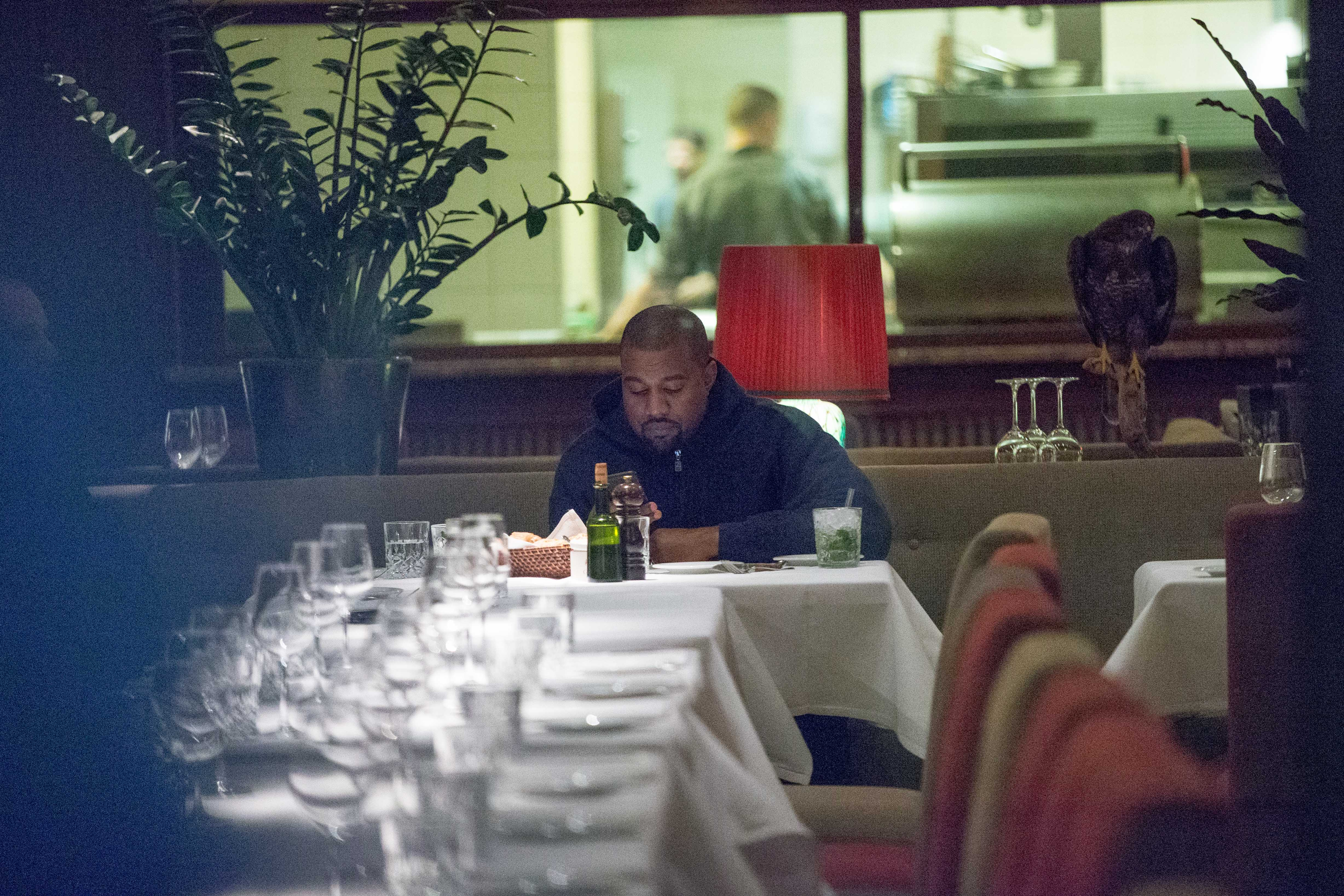 Kanye West dining alone in Berlin