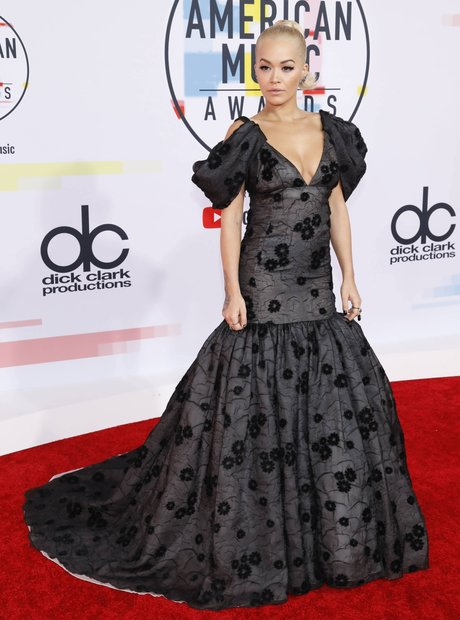 Rita Ora Rocked A Black Dress With A Plunging V Neck And Some